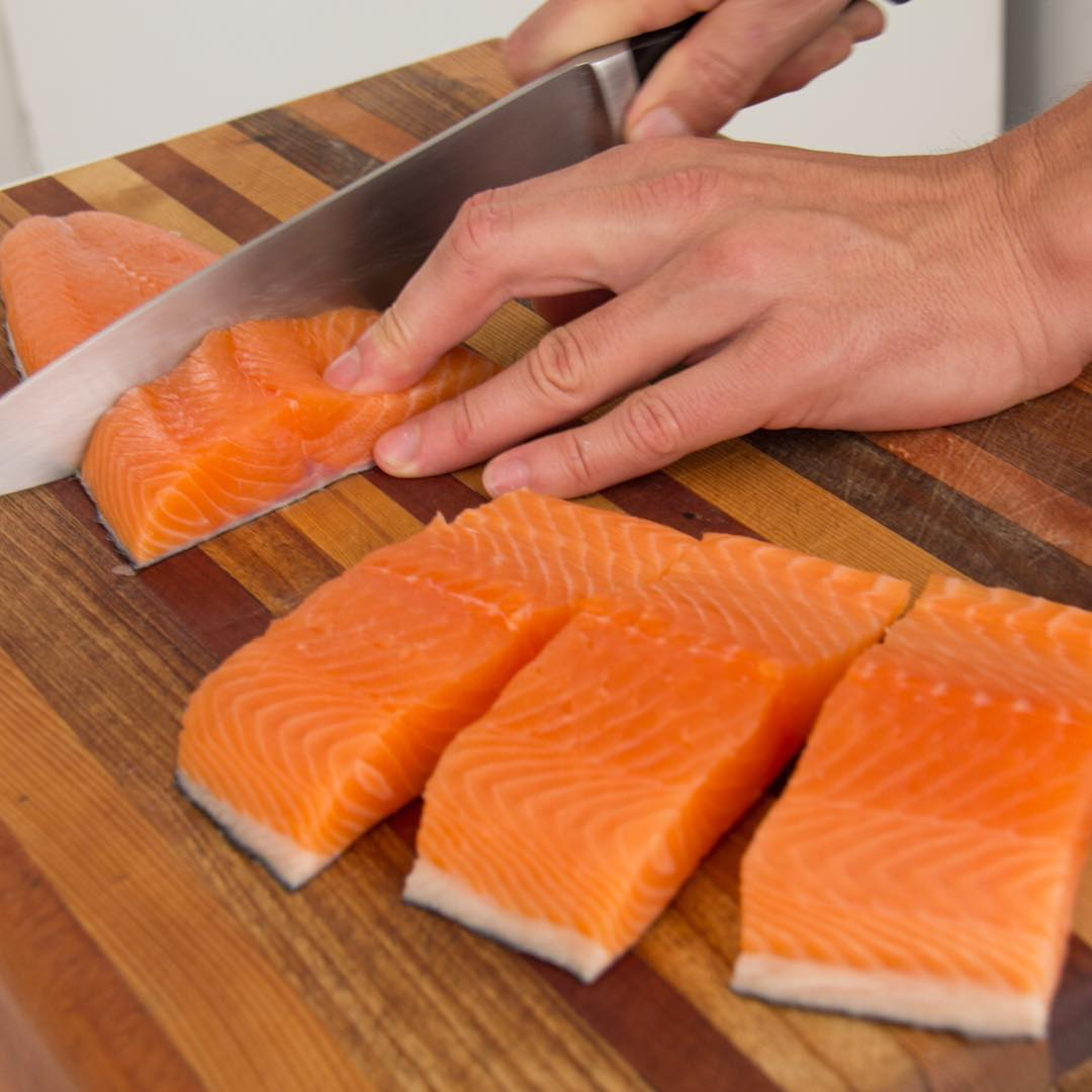Atlantic Sapphire Salmon being Cut Up